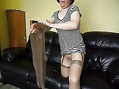 Shiny pantyhose,nylons with the addition of dildo